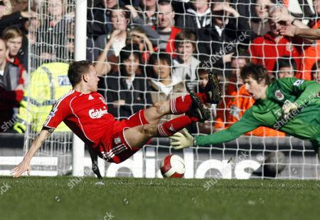 Manchester United Goalkeeper Edwin van Der Saar saves the shot from Craig Bellamy of Liverpool
