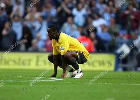 Johann Djourou of Arsenal looks dejeced after losing 1-0 to Manchester City