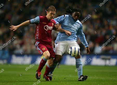 Stephen Davies of Aston Villa and Kiki Musampa of Manchester City