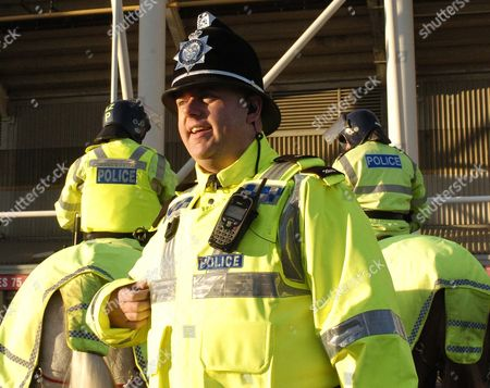 PC Peter Gill talks to supporters outside the Riverside Stadium, Middlesbrough as the mounted division oversees a quiet afternoon at a premiership football game
