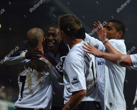 Khalilou Fadiga is congratulated on scoring by his Bolton Wanderers teammates