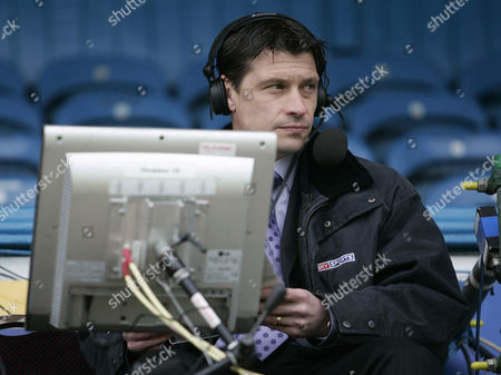 Former player Tony Cottee prepares for match commentary for Sky Sports