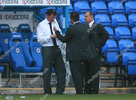 Fulham caretaker manager Lawrie Sanchez talks to Fulham MD David McNally and and Deputy MD Mark Collins, far right, after the match