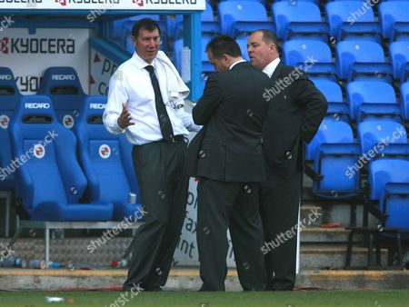 Fulham caretaker manager Lawrie Sanchez talks after the match to Fulham MD David McNally and and Depury MD Mark Collins, far right, after the match