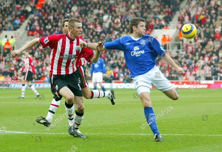 Everton's former Saints player James Beattie smashes the ball on the volley towards goal with Southampton's Callum Davenport