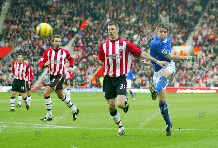 Everton's former Saints player James Beattie smashes in effort towards goal past Southamptonn's Callum Davenport