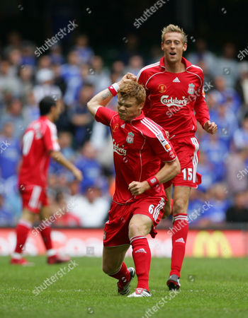 John Arne Riise of Liverpool celebrates his goal as Peter Crouch follows