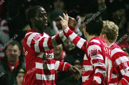 Mark McCammon of Doncaster Rovers celebrates his goal