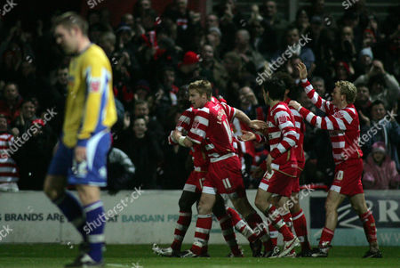 Mark McCammon of Doncaster Rovers celebrates scoring the first goal with team-mates