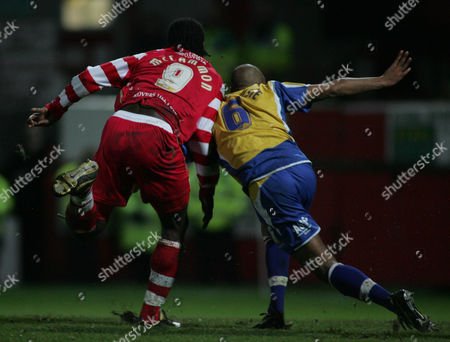 Mark McCammon of Doncaster Rovers scores the first goal