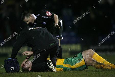 Gary Doherty of Norwich City receives treatment after getting injured just before conceding the opening goal of the game