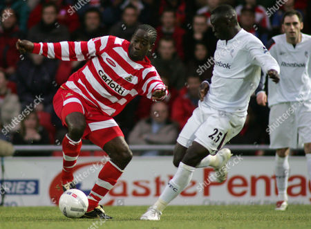 Mark McCammon of Doncaster Rovers and Abdoulaye Faye of Bolton Wanderers