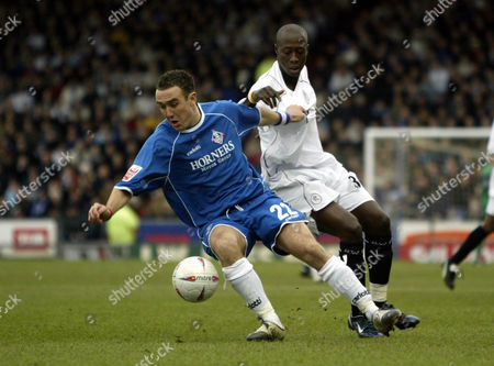 30 January 2005 - Oldham Athletic manager Lee Croft and Bolton Wanderers  Khalilou Fadiga battle for the ball