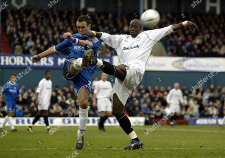 30 January 2005 - Oldham AthleticLee Croft clears from Bolton Wanderers Khalilou Fadiga