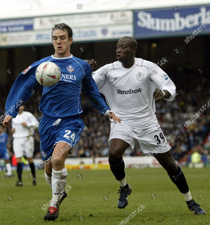 30 January 2005 - Oldham Athletic Mark Hughes and Bolton Wanderers Khalilou Fadiga challenge for the ball