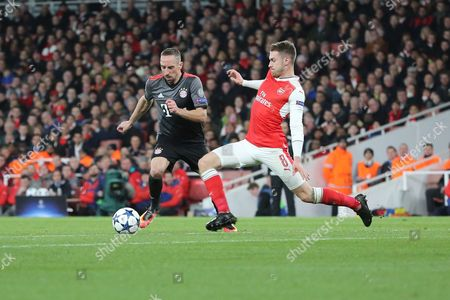 Arsenal midfielder Aaron Ramsey (8) tackling Bayern Munich attacker Frank Ribery (7) during the Champions League round of 16, game 2 match between Arsenal and Bayern Munich at the Emirates Stadium, London