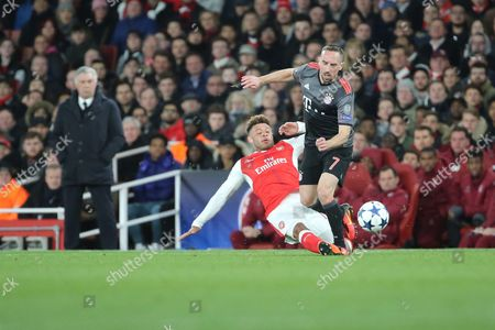 Arsenal midfielder Alex Oxlade-Chamberlain (15) tackling Bayern Munich attacker Frank Ribery (7) during the Champions League round of 16, game 2 match between Arsenal and Bayern Munich at the Emirates Stadium, London