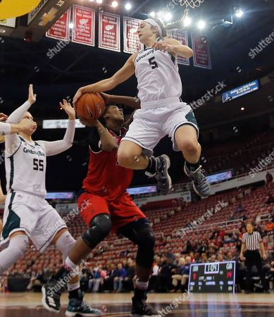 Brianne Cohen, Laken James Green Bay guard Laken James (5) blocks an attempted shot by Detroit forward Brianne Cohen during the first half of an NCAA college basketball game in the championship of the Horizon League conference tournament, in Detroit