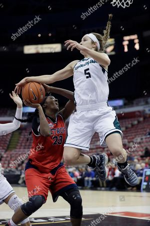 Brianne Cohen, Laken James Green Bay guard Laken James (5) blocks a shot by Detroit Mercy forward Brianne Cohen (23) during the first half of a Horizon League NCAA championship college basketball game, in Detroit