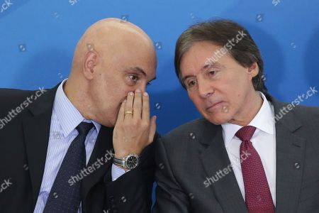 Alexandre de Moraes, Eunicio Oliviera Brazil's Minister of the Supreme Court Alexandre de Moraes, left, talks with Senate President Eunicio Oliveira, during a swearing-in ceremony of newly-named ministers, at the Planalto Presidential Palace, in Brasilia, Brazil