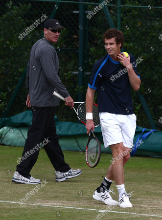 Andy Murray of Great Britain on a practice court with coach Brad Gilbert