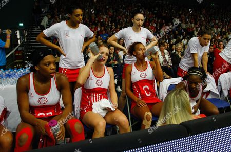England Netball Head Coach Anna Mayes Gives A Team Talk As Sara Bayman and Serena Guthrie Drink From Maxitone Bottles Gb Worcester