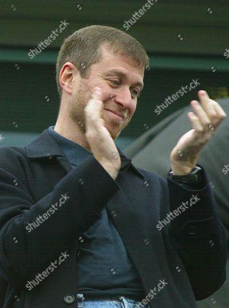 Chelsea's billionaire owner Roman Abramovic applaudes the crowd