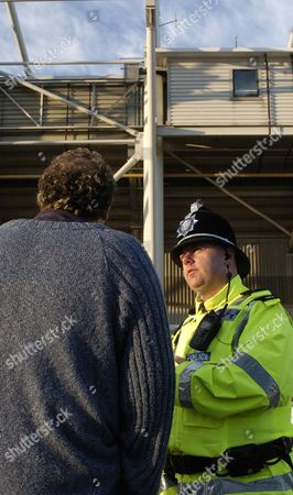 PC Peter Gill talks to supporter Dan McCole outside the Riverside Stadium, Middlesbrough