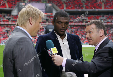 Ray Stubbs from BBC Sport interviews Peter Schmeichel, left and Marcel Desailly