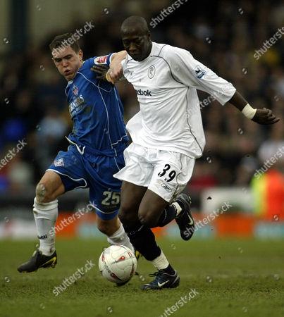 30 January 2005 - Oldham Athletic Neil Kilkenny  tackles Bolton Wanderers  Khalilou Fadiga