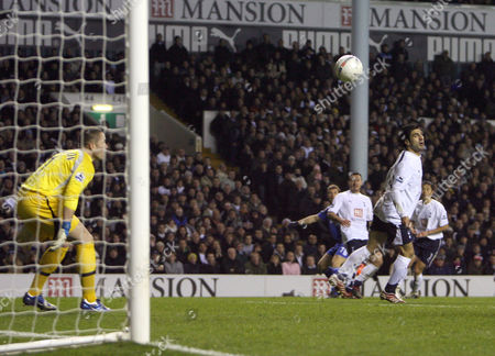 From a seemingly impossible angle, Andriy Schevchenko (in background) of Chelsea scores the opening goal of the game past Tottenham goalkeeper Paul Robinson