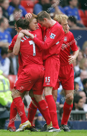 Peter Crouch and goalscorer John Arne Riise of Liverpool celebrate the opening goal