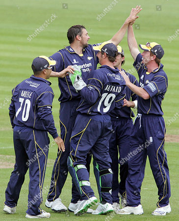 Steve Harmison of Durham Dynamos celebrates the wicket of Robert Key of Kent Spitfires with Paul Collingwood and other team mates