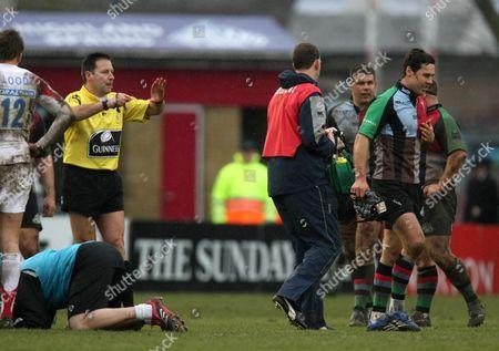 Referee Martin Fox sends off De Wet Barry (r) of Harlequins