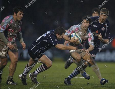 Mark Regan of Bristol Rugby tackles Jerome Fillol of Stade Francais.