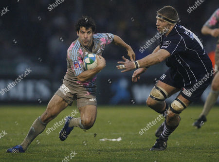 Stade Francais scrum half Jerome Fillol goes past Sean Hohneck of Bristol Rugby.