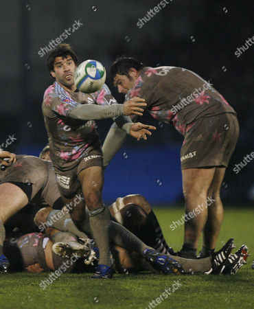 Jerome Fillol of Stade Francais releases the ball from the ruck.