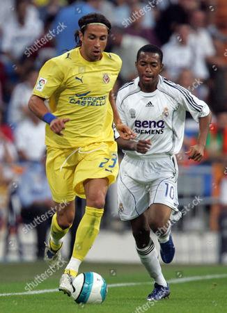 Jose Mari of Villareal and Robinho of Real Madrid