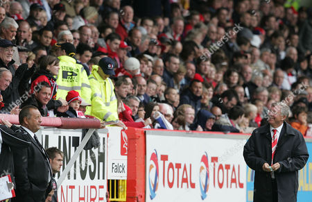Manager Sir Alex Ferguson of Manchester United is all smiles as he recieved warmly at Aberdeen in front of the directors box and Aberdeen manager Jimmy Calderwood