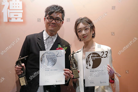 """Gordon Lam, Zhou Dongyu Hong Kong actor Gordon Lam, left, and Chinese actress Zhou Dongyu pose with their trophies of the Best Actor and Best Actress Awards at the Hong Kong Film Critics Society Awards for their movies """"Trivisa"""" and """"Soul Mate"""" in Hong Kong"""