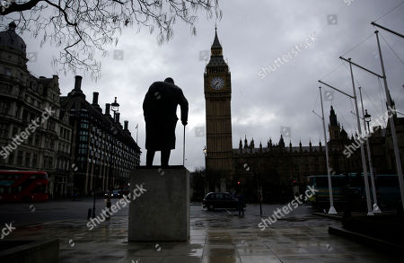 A statue of Winston Churchill in front of the Houses of Parliament in London,. Britain's Treasury chief Philip Hammond, is set to deliver an upbeat message as he unveils a cautious budget meant to help the country bolster resources as it faces the uncertainty of leaving the European Union