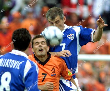 Rtd114 - 20000625 - Rotterdam Netherlands : Dutch Player Philip Cocu (c) Goes For a Header Against Yugoslav Player Vladimir Djukic (r) Watch by Predrag Mijatovic (l) During the Quarter-final Match Netherlands Vs Yugoslavia at the Euro 2000 Soccer Championships in Rotterdam Sunday 25 June 2000 Epa Photo Netherlands Rotterdam