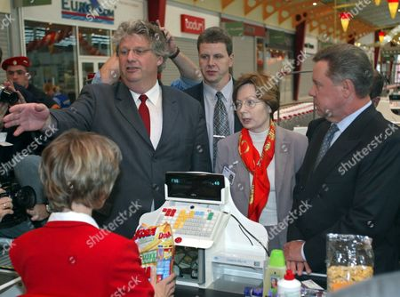 Moscow Russian Federation : the Head of Aushan Hypermarkets Net in Russia Patrick Longuet (l) Gestures As Governor of the Moscow Region Boris Gromov (r) Looks on During the Opening Ceremony of the First French Hypermarket Aushan in Moscow 27 August 2002 the Shopping Center Includes 16 000 Square Meters Hypermarket 60 Additional Non-food Shops 12 Restaurants and Cafes During 3-4 Years Aushan Plans to Open 10 Hypermarkets Investing About $300 000 000