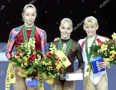 Debrecen Hungary : Medalists of the Floor Category (ltr) Second Placed Verona Van Der Leur of the Netherlands Winner Spanish Elena Gomez and Bronze Medalist Samantha Seehan of Usa on the Podium at the 36th World Gymnastics Championships in Debrecen on Sunday 24 November 2002