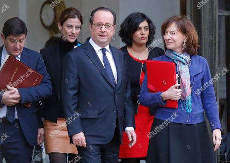 French President Francois Hollande walks out of the Elysee Palace followed by, from left clock-wise, Sports Minister Patrick Kanner, State Secretary in charge of Victims Juliette Meadel, Labor Minister Myriam El Khomri and Annick Girardin Minister of Public Function after the weekly cabinet meeting in Paris, France
