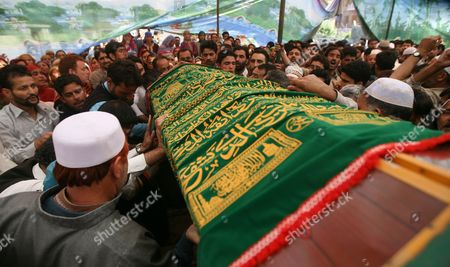 People Carry the Coffin of Haji Syed Mohammad Yousuf who Allegedly Died in Police Custody During His Funeral in Locktipora Some 55 Kilometers South of Srinagar the Summer Capital Indian Kashmir 01 October 2011 Haji Syed Mohammad Yousuf a 61-year-old Retired Teacher and National Conference (nc) Party Worker Allegedly Died in Police Custody on 30 September After the Disputed Region's Top Senior (nc) Minister Handed Him Over to Investigators For His Alleged Involvement in a Bribery Case India Srinagar