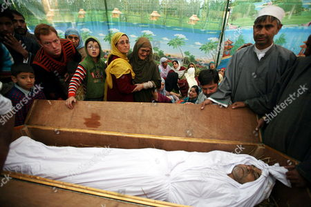 Relatives Mourn at the Open Coffin of Haji Syed Mohammad Yousuf who Allegedly Died in Police Custody During His Funeral in Locktipora Some 55 Kilometers South of Srinagar the Summer Capital Indian Kashmir 01 October 2011 Haji Syed Mohammad Yousuf a 61-year-old Retired Teacher and National Conference (nc) Party Worker Allegedly Died in Police Custody on 30 September After the Disputed Region's Top Senior (nc) Minister Handed Him Over to Investigators For His Alleged Involvement in a Bribery Case India Srinagar