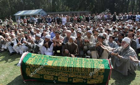 People Offer Special Prayers at the Coffin of Haji Syed Mohammad Yousuf who Allegedly Died in Police Custody During His Funeral in Locktipora Some 55 Kilometers South of Srinagar the Summer Capital Indian Kashmir 01 October 2011 Haji Syed Mohammad Yousuf a 61-year-old Retired Teacher and National Conference (nc) Party Worker Allegedly Died in Police Custody on 30 September After the Disputed Region's Top Senior (nc) Minister Handed Him Over to Investigators For His Alleged Involvement in a Bribery Case India Srinagar