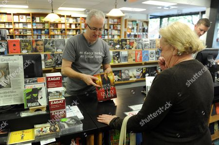 Bookseller Shane Cagney (l) Sells a Copy of 'In My Time' a New Book by Former Us Vice President Dick Cheney to Customer July Finley (r) Former Chairman of the Dc Republican Committee at Politics and Prose Bookstore in Washington Dc Usa 30 August 2011 Cheney's Book Goes on Sale 30 August and is Reported to Criticize Former Secretary of State Colin Powell Republican Senator From Arizona John Mccain and Others United States Washington