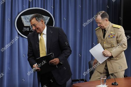 Us Defense Secretary Leon Panetta (l) and Chairman of the Joint Chiefs of Staff Admiral Mike Mullen (r) Walk Away After Holding a News Briefing at the Pentagon in Arlington Virginia Usa 20 September 2011 Secretary Panetta Discussed the Dadt (don't Ask Don't Tell) Policy the Us Military's Former Ban on Openly Gay Troops Which Officially Ends 20 September 2011 United States Arlington